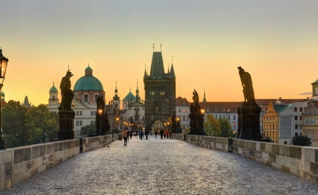Charles bridge with statues and gate by sunset on private tour prague