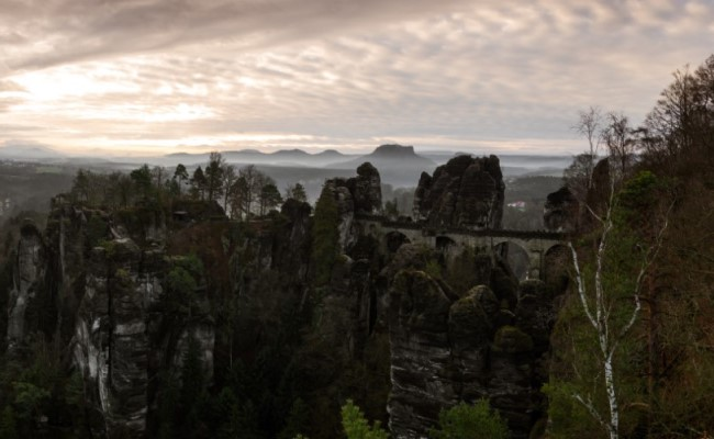 Panorama of bastei view bridge between rock formations in Bohemian Saxony Switzerland park
