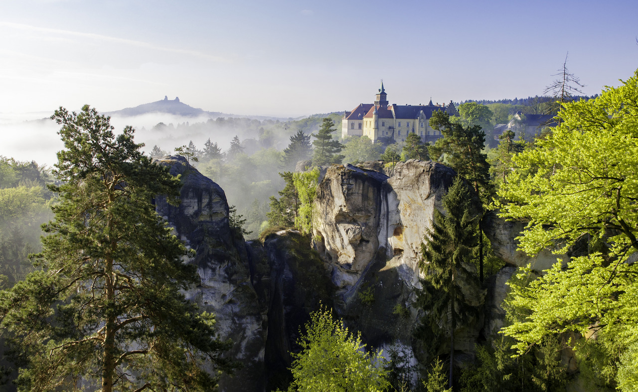 View of castles and rocks coming out of the fog in Bohemian Paradise national park