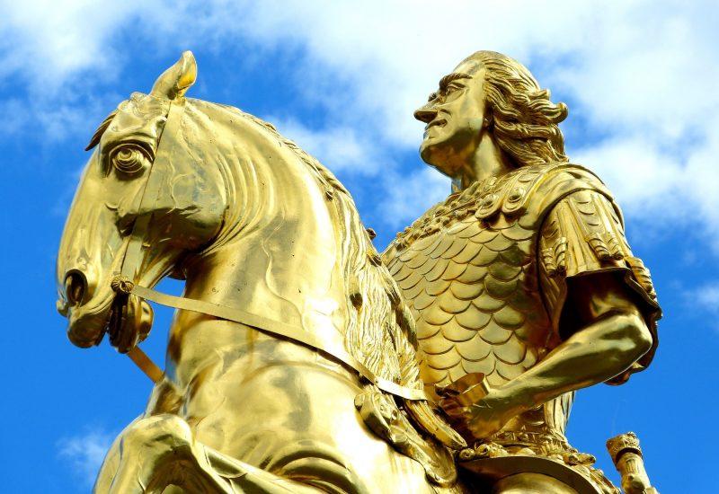 Upper part of golden statue of rider on horse in Dresden