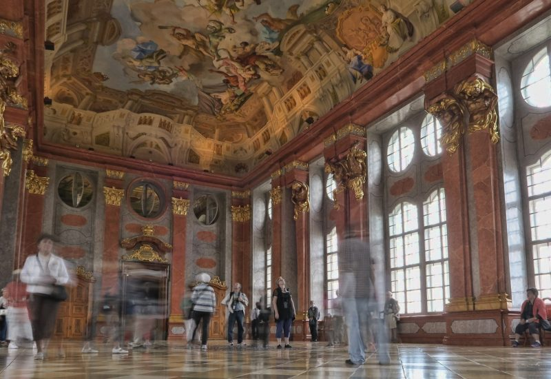 Melk Abbey marble hall with high windows and ceiling fresco on a private trip