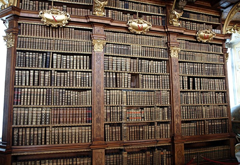 Melk Abbey library with old books in high wooden shelves
